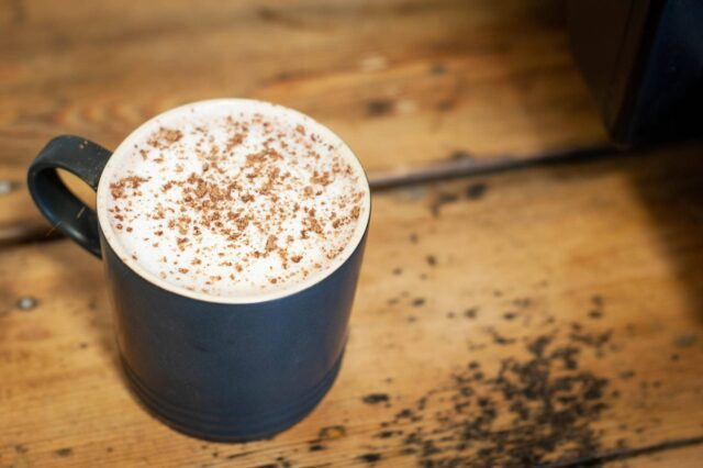 hot chocolate with chocolate powder sprinkled on top