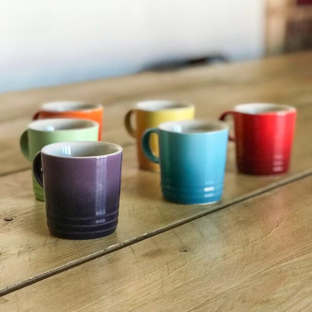 6 small mugs sitting on a table