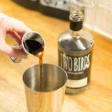 Pouring espresso liqueur into cocktail shaker