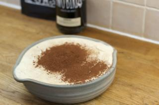 cover the top layer with a coating of cocoa powder and serve