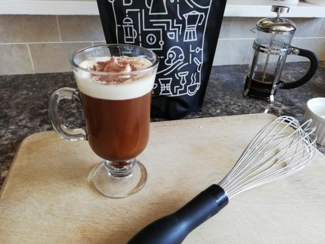 Irish coffee sprinkled with chocolate