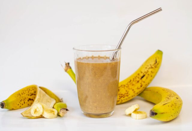 Glass of coffee smoothie with bananas