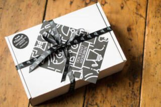 White Two Chimps gift box tied with black ribbon fixed with gift note